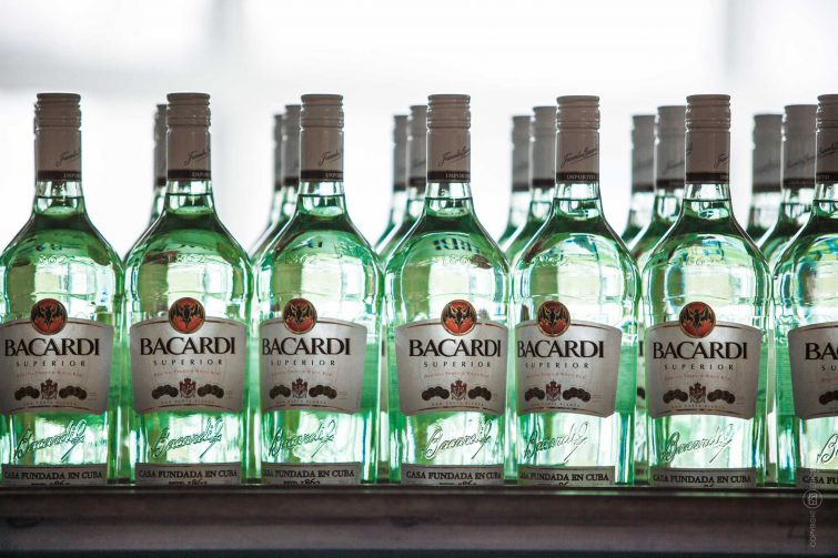 Illuminated bottles at the Bacardi factory. | © Eric Shambroom Photography